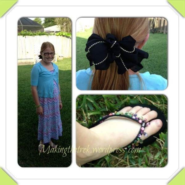 Youngest diva sporting her Kohl's blingy flip flops, and hand me down dress and cardi and a hairbow stolen from Mimi long ago!