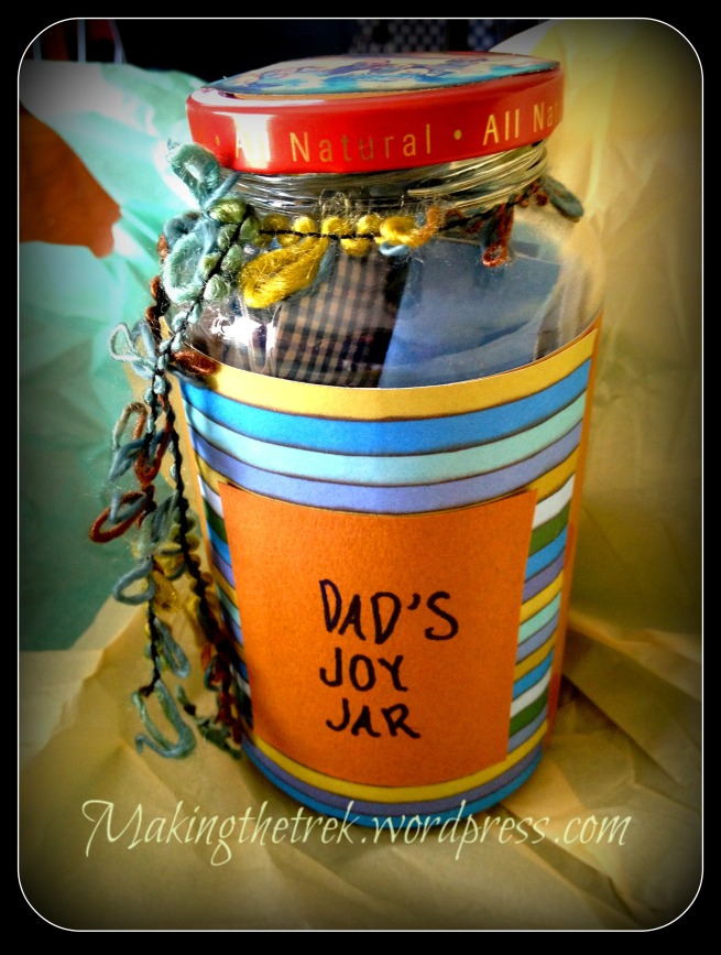 Pasta jar.  Cleaned.  Scrapbook paper cut and glued with fancy ribbon to tie around top